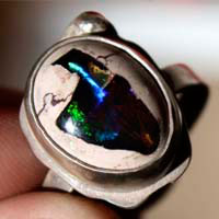 A thousand fires, reflection ring in sterling silver and cantera opal