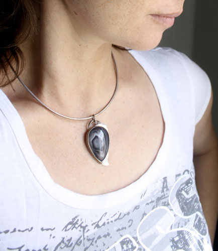 Eagle eye, raptor head pendant in sterling silver and Botswana agate