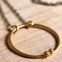 Gold enclosure, circle of the couple necklace in gold and sterling silver