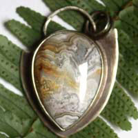 Kaari, arrowhead pendant in sterling silver and Mexican crazy lace agate