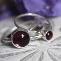Purple from the Orient, sterling silver stacking rings with garnet, purple