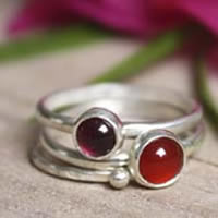 Shades of Cochineal, sterling silver stacking rings with garnet and carnelian