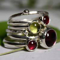 A nap under the trees, stackable rings in sterling silver, garnet, peridot and a vintage purple glass cabochon