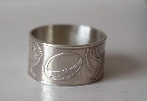 Conviction, personal symbols ring in sterling silver