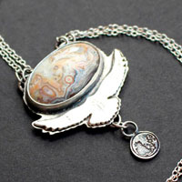 Unfold your wings, eagle carrying the full moon necklace in sterling silver and Mexican crazy lace agate
