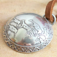 Cave painting, prehistoric hunting scene necklace in sterling silver