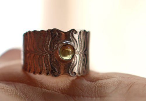 Fern flower, legend from Eastern Europe ring in sterling silver and peridot