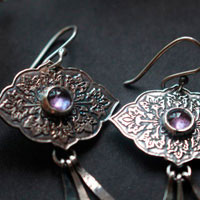 Magnolia, flower language earrings in sterling silver and alexandrite