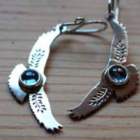 Messages at dawn, eagle earrings in sterling silver and blue zircon