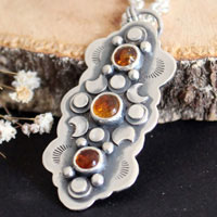 The cycle of seasons: autumn, autumn equinox necklace in sterling silver and Baltic amber