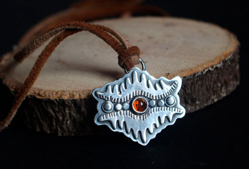 The eye of the earth, tribal mountain necklace in sterling silver and amber